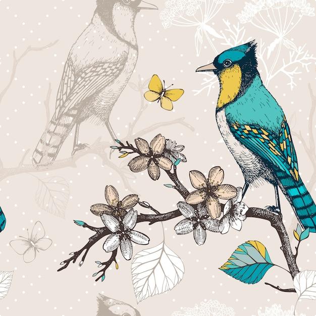 Padrão sem emenda com tinta mão desenhados pássaros nos galhos de árvores florescendo. fundo de desenho vintage com pássaros verdes Vetor Premium