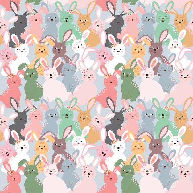 Padrão sem emenda de coelhos coloridos bonitos no fundo azul pastel Vetor Premium