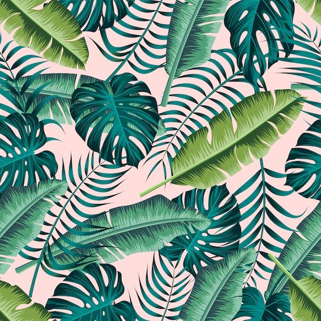 Padrão sem emenda de folhas tropicais Vetor Premium