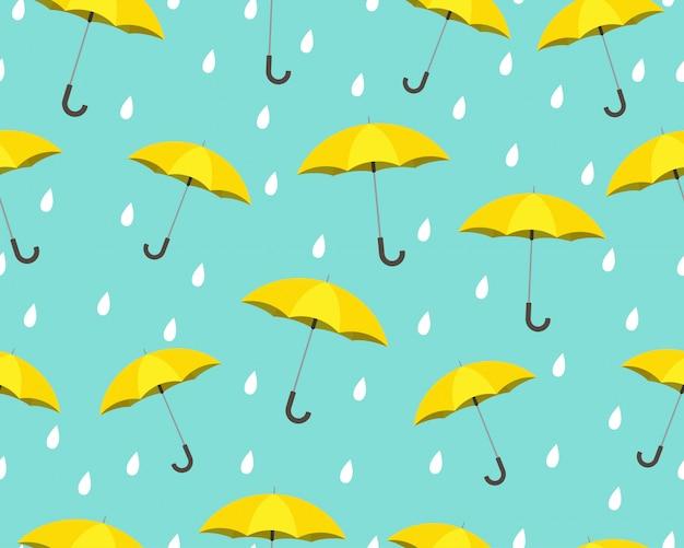 Padrão sem emenda de guarda-chuva amarelo com gotas chovendo Vetor Premium