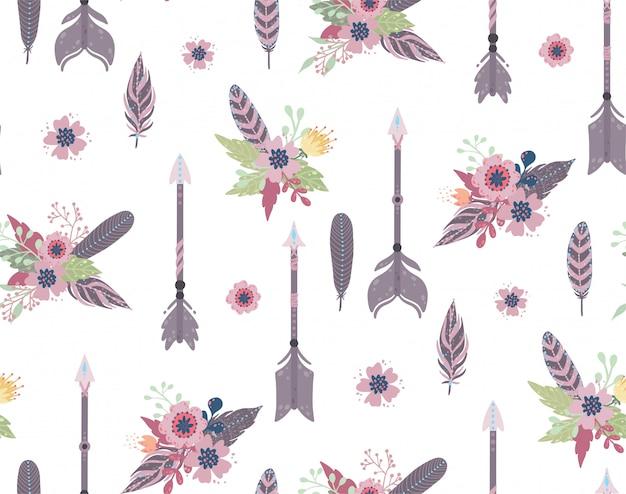 Padrão sem emenda étnica de penas, flechas e flores. Vetor Premium