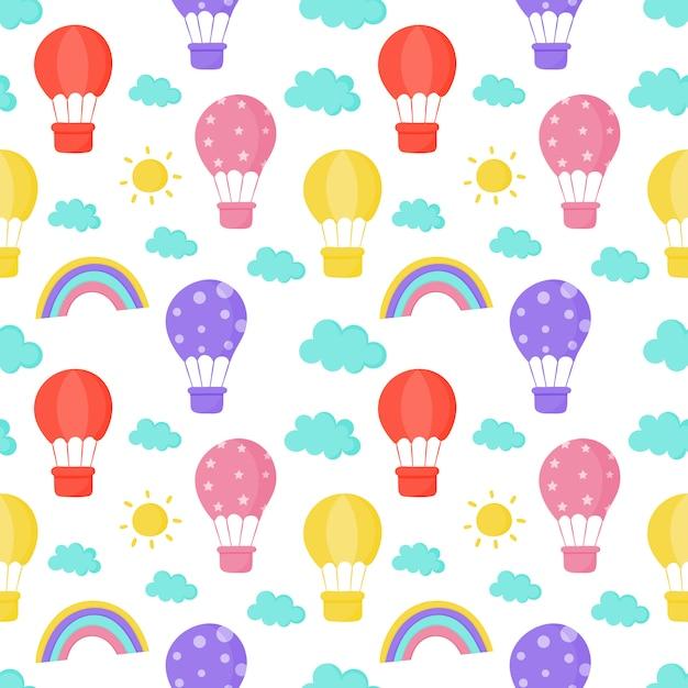 Padrão sem emenda sol, balão, arco-íris e nuvens vetor Vetor Premium