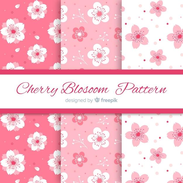 Padrões de flor de cerejeira de tinta Vetor grátis