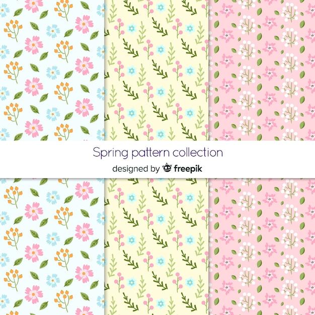 Padrões de flores de primavera mão desenhada Vetor grátis
