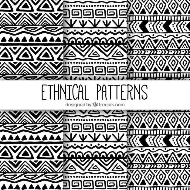 Padrões de mão desenhar formas étnicas Vetor grátis