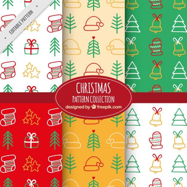 Padrões decorativos com elementos desenhados à mão para o natal Vetor grátis