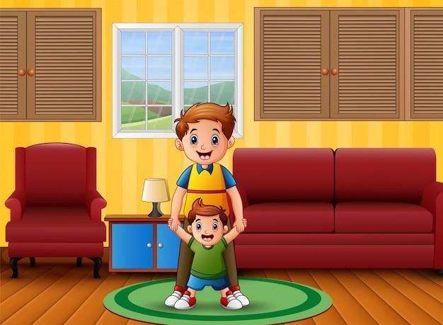 Pai e filho na sala Vetor Premium