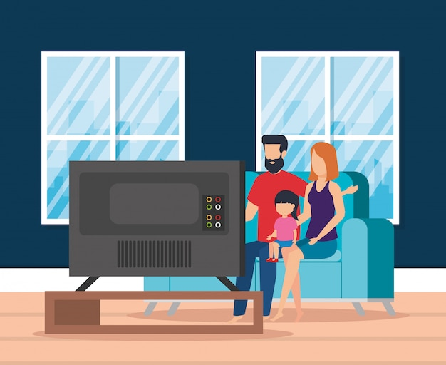 Pais com a filha assistindo televisão Vetor grátis