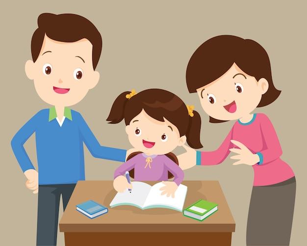 Pais e filha fazendo lição de casa Vetor Premium