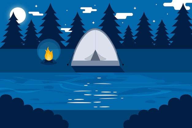 Paisagem de área de acampamento de design plano com barraca à noite Vetor grátis