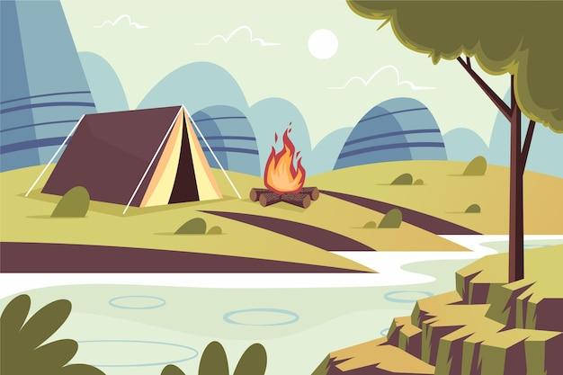 Paisagem de área de acampamento de design plano com barraca e fogueira Vetor grátis