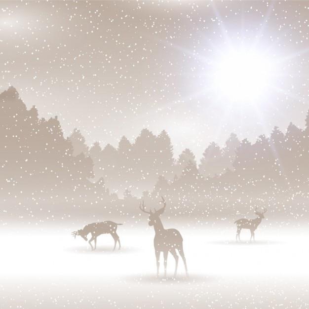 Paisagem do inverno com deers Vetor grátis