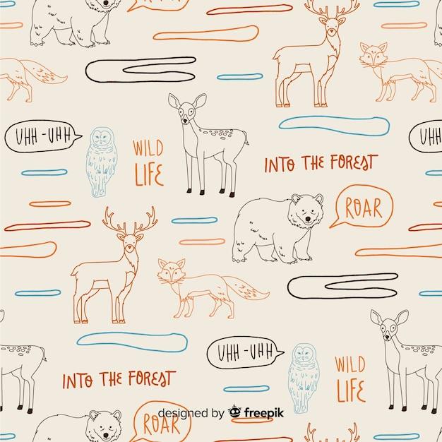 Palavras de mão desenhada e padrão de animais da floresta Vetor grátis