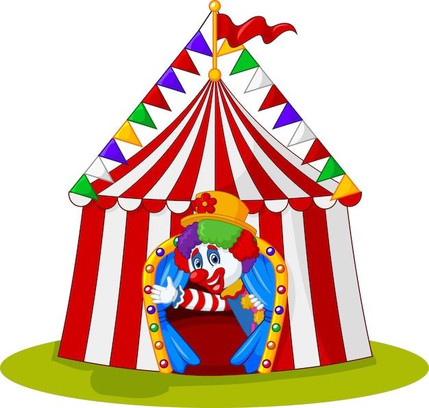 Palhaço dos desenhos animados, acenando com a mão na tenda do circo Vetor Premium