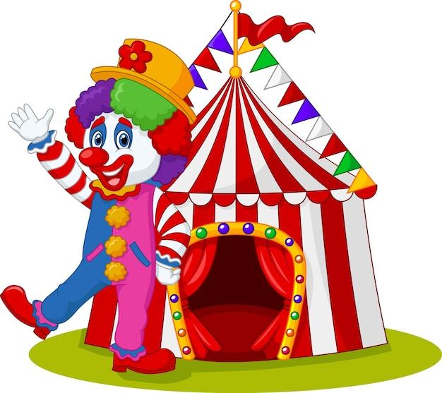 Palhaço feliz acenando com a tenda de circo no fundo isolado Vetor Premium