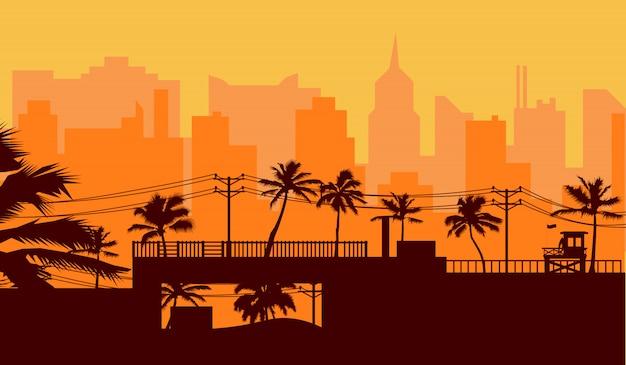 Palmeira silhueta na praia e paisagem urbana sob o céu do sol Vetor Premium
