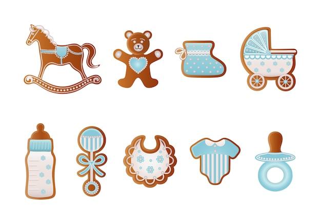 Pão de mel de gengibre. biscoitos azuis para menino. cavalo de balanço, urso, sapato de bebê, carrinho de bebê, biberão, chupeta, vestido, chocalho e biberão Vetor Premium