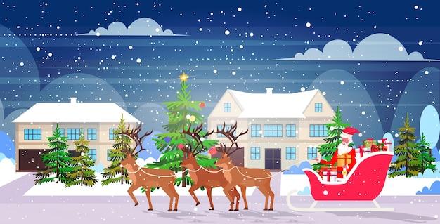 Papai noel andando de trenó com renas feliz natal feliz ano novo férias de inverno conceito celebração paisagem com neve Vetor Premium