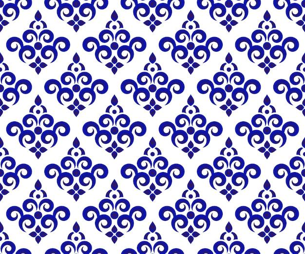 Papel de parede sem costura floral azul e branco e padrão de cerâmica, design de fundo de porcelana Vetor Premium