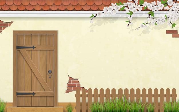 Parede de estuque de uma casa com uma porta de madeira velha Vetor Premium