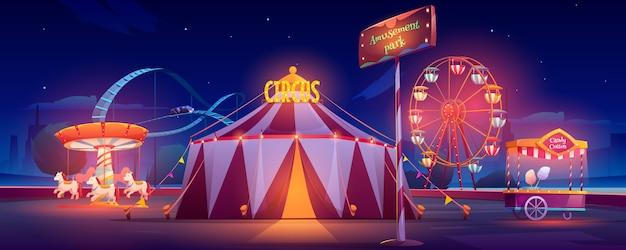 Parque de diversões à noite Vetor Premium