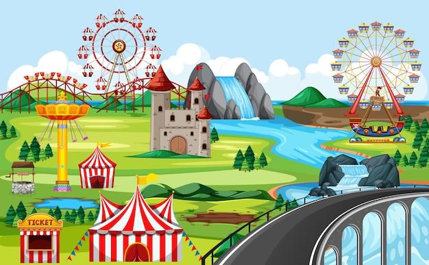 Parque de diversões com paisagem temática de ponte e muitos brinquedos Vetor grátis