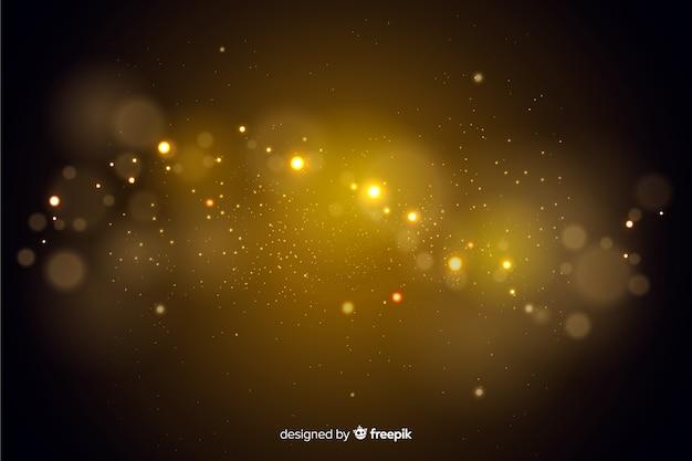 Partículas de ouro bokeh fundo decorativo Vetor grátis