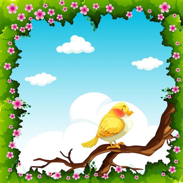 Pássaro amarelo no galho Vetor grátis