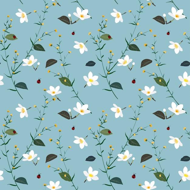 Pastel padrão sem emenda com flor selvagem no fundo azul suave Vetor Premium