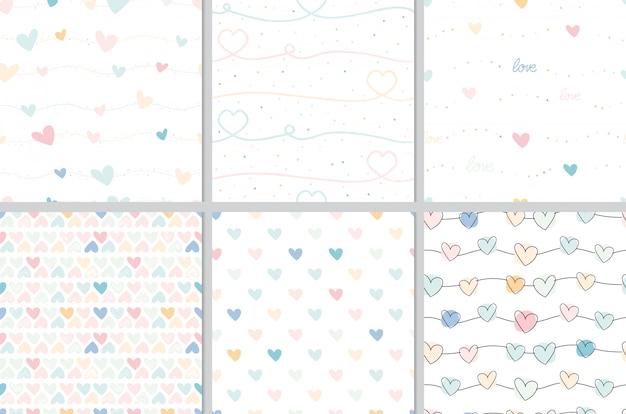 Pastel valentine doodle coração sem costura padrão coleção Vetor Premium