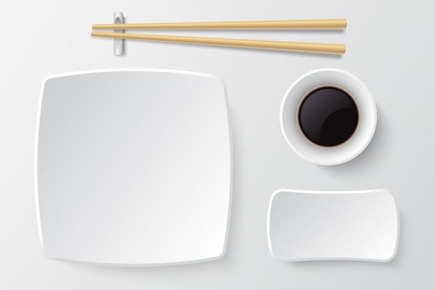Pauzinhos e prato de sushi vazio. pratos asiáticos em restaurantes Vetor Premium