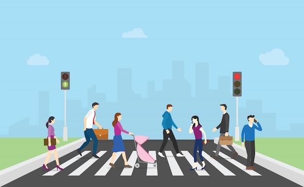 Pedestre atravessar a rua com pessoas da equipe e semáforo e cidade Vetor Premium