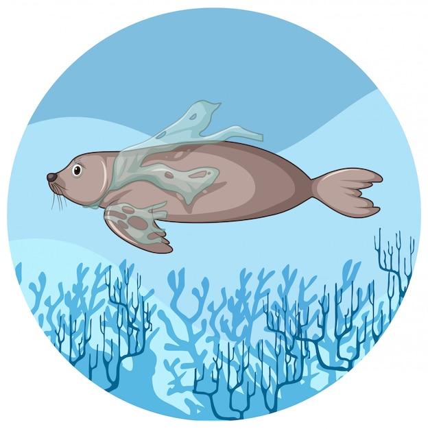 Peixe-boi e sacos de plástico debaixo d'água Vetor Premium