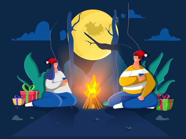 Personagem de casal feliz desfrutando de bebida com caixas de presente e fogueira na vista da natureza lua cheia. cartão de felicitações Vetor Premium