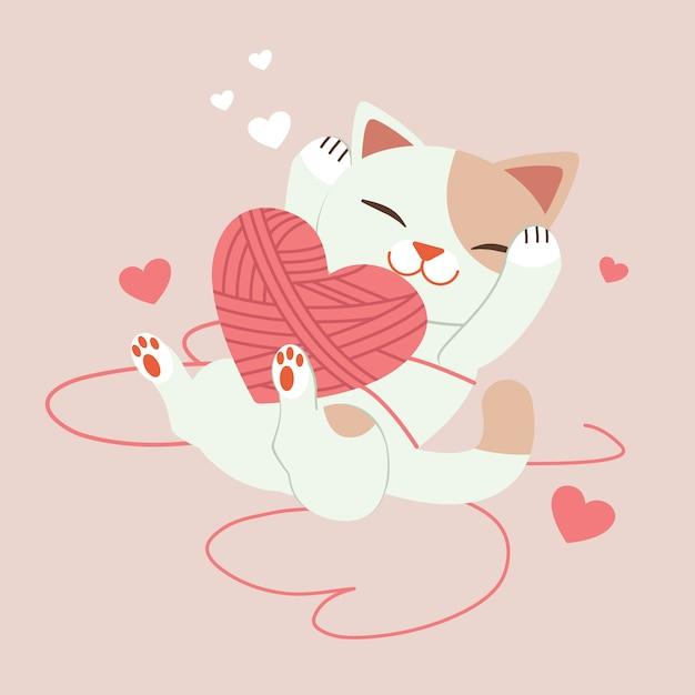 Personagem de gato bonito brincando com fios com um coração na rosa Vetor Premium