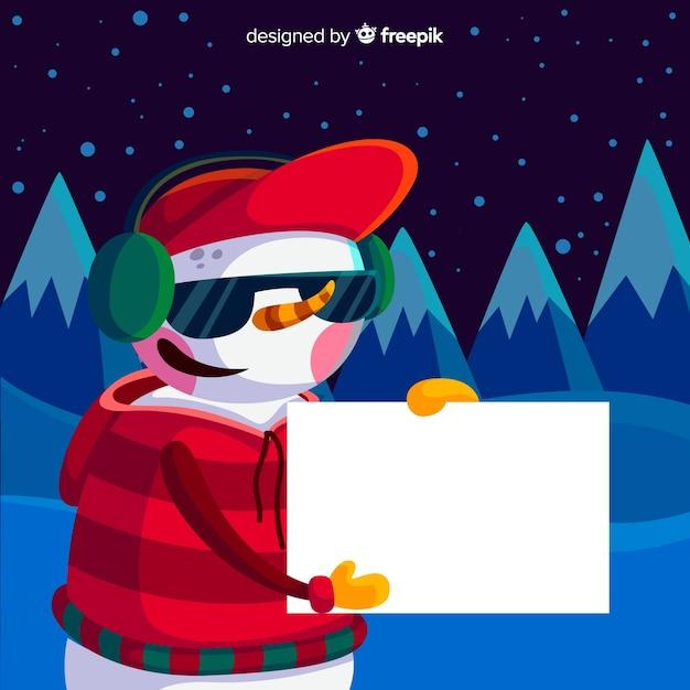 Personagem de natal plana segurando o cartão vazio branco Vetor grátis