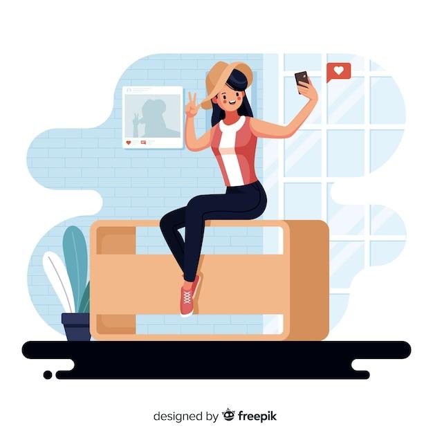 Personagem feminina design plano, tendo selfie dentro de casa Vetor grátis