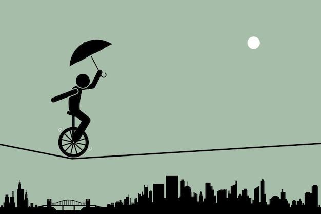 Pessoa andando de monociclo e equilibrando-o com um guarda-chuva passando por uma corda bamba com a silhueta da cidade ao fundo. Vetor Premium