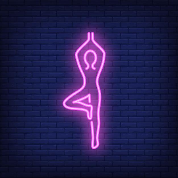 Pessoa, fazendo, ioga, sinal néon Vetor grátis