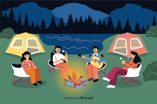 Pessoas acampar no design plano de natureza Vetor grátis