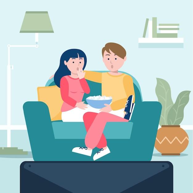 Pessoas assistindo a um filme em casa com pipoca Vetor grátis
