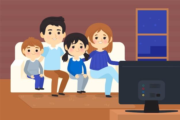 Pessoas assistindo a um filme em casa na tv Vetor grátis