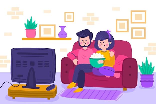 Pessoas assistindo a um filme em casa Vetor grátis