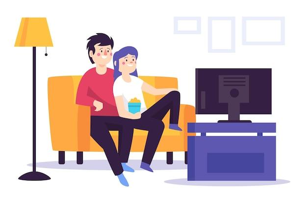 Pessoas assistindo a um filme juntos em casa Vetor grátis