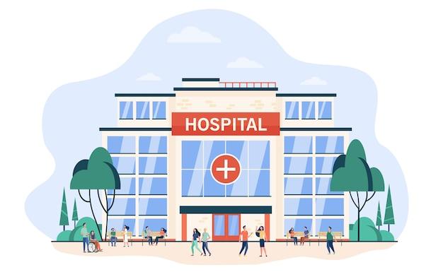 Pessoas caminhando e sentadas no prédio do hospital. exterior em vidro da clínica da cidade. ilustração em vetor plana para ajuda médica, emergência, arquitetura, conceito de saúde Vetor grátis
