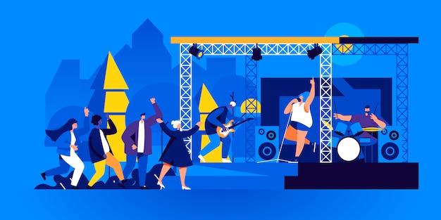 Pessoas dançando na frente do palco ao ar livre com a banda de música Vetor Premium