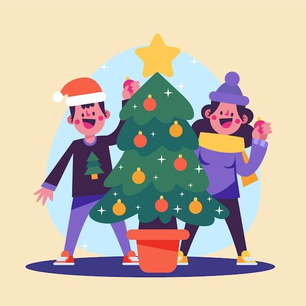 Pessoas decorando a árvore de natal Vetor grátis