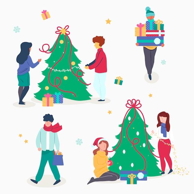Pessoas decorando o pacote de árvore de natal Vetor grátis