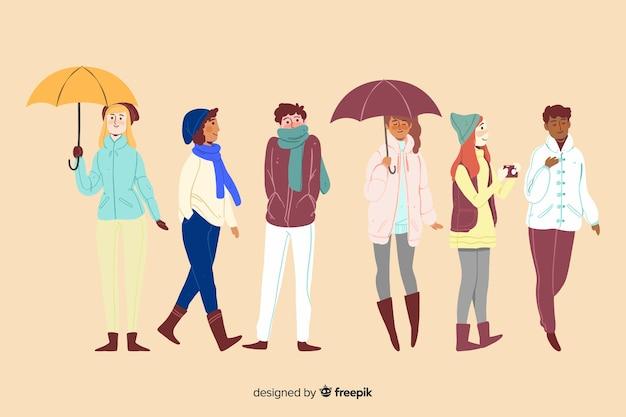 Pessoas diferentes no parque outono Vetor grátis