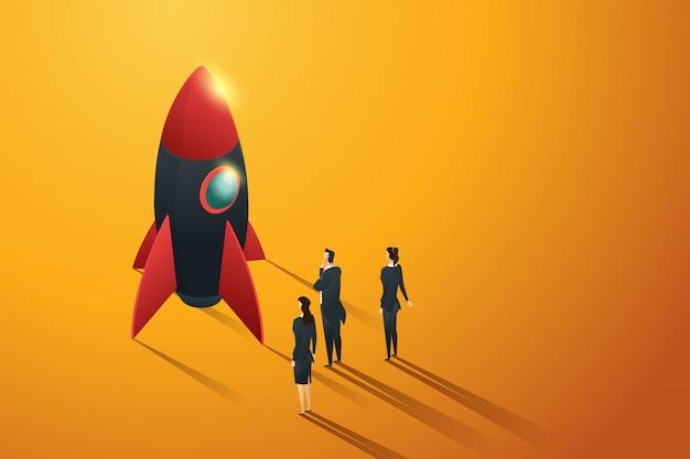 Pessoas do grupo de negócios de inicialização em pé vista para um foguete, conceito isométrico. ilustração Vetor Premium